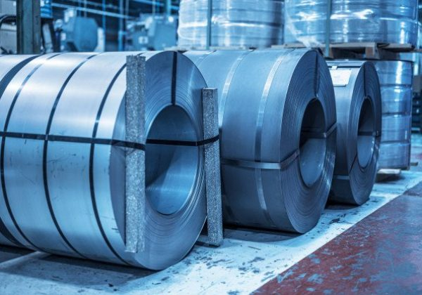 industrial-background-big-size-steel-coil-stored-inside-industrial-warehouse-blue-toned-image_56854-2868